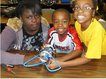 Mop Top Campers building a walking robot with soda cans!